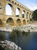 Pont du Gard. The Pont du Gard is a part of the ancient Roman Nîmes  aqueduct that crosses the Gardon River in southern France Royalty Free Stock Images