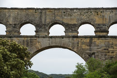 Pont du Gard. In Provence, France, over the Gardon river, is an 160 foot high roman aqueduct built to provide water to the city of Nimes from the river Eure Royalty Free Stock Photography