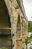 Pont du Gard. In Provence, France, over the Gardon river, is an 160 foot high roman aqueduct built to provide water to the city of Nimes from the river Eure Stock Photos