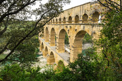 Pont du Gard. In Provence, France, over the Gardon river, is an 160 foot high roman aqueduct built to provide water to the city of Nimes from the river Eure Stock Photo