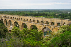 Pont du Gard. In Provence, France, over the Gardon river, is an 160 foot high roman aqueduct built to provide water to the city of Nimes from the river Eure Stock Image