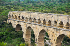 Pont du Gard. In Provence, France, over the Gardon river, is an 160 foot high roman aqueduct built to provide water to the city of Nimes from the river Eure Royalty Free Stock Image