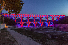 Pont du Gard Provence. The Pont du Gard roman bridge with arches in Provence, France pink lighten at night Stock Images