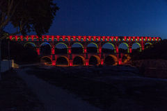 Pont du Gard Provence. The Pont du Gard roman bridge with arches in Provence, France red lighten at night Stock Images