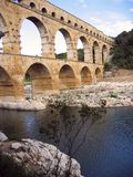 Pont du Gard roman aquaduct nimes river france. Pont du Gard Roman aqueduct used to carry water to the city of Nimes, in the South of France, crossing the river royalty free stock photos