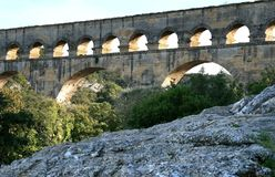 Pont du Gard, a Roman aqueduct in France. The Pont du Gard is an aqueduct in the South of France constructed by the Roman Empire, and located in Vers-Pont-du Stock Images