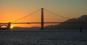 Pont en porte d'or, coucher du soleil de San Francisco Photo libre de droits
