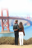 Pont en porte d'or de San Francisco - couple de course Photo stock