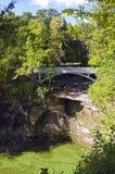 Pont et gorge de parc d'état de Minneopa Photos stock