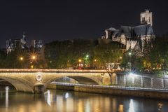 Pont Louis Philippe at night. Pont Louis Philippe and Eglise Saint-Gervais at night. Paris. France Stock Image