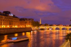 Pont Neuf, Paris, France. Pont Neuf and Cite island over Seine river with Paris cityscape at night, France Stock Images
