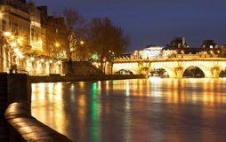 The Pont Neuf New Bridge and Seine river at night , Paris, France. The Pont Neuf New Bridge , the oldest standing bridge across the river Seine in Paris, France Stock Photography