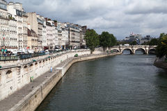 Pont Neuf Paris. The Pont Neuf and the historical buildings at the shore of the Seine River, Paris, France Stock Photo