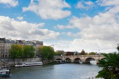Pont Neuf, Paris, France. Pont Neuf and river Seine embankment, blue sky with clouds, Paris, France Royalty Free Stock Images