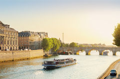 Pont Neuf, Paris, France. Pont Neuf and Seine river with tour boat at sunny summer sunset, Paris, France Royalty Free Stock Photos
