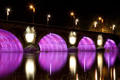 Pont Neuf Toulouse, France. Pont Neuf in Toulouse colorfully lit at night, the color is changing between purple, orange, green, red, blue Stock Image