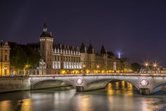 Pont St.-Michel Bridge at night. Night time in Paris looking across the Seine at the Pont St.-Michel bridge Royalty Free Stock Photography