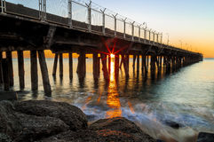 Pont Thermal Badalona. Sunrise with the sun between columns Royalty Free Stock Image