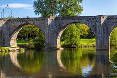 Pont Vieux, France. Pont Vieux crossing the Aude river in Carcassone with green trees and blue sky on a summer spring day Royalty Free Stock Images
