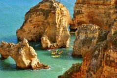 Ponta Da Piedade tourists kayaking through the spectacular rock formations royalty free stock image