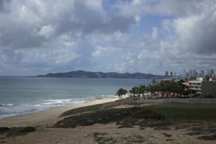 Ponta Negra beach in Natal, RN, Brazil. The Morro do Careca lit. `Bald Hill` is a large dune located in the city of Natal in Brazil. It is the main symbol and a Stock Photography