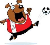 Pontapé do futebol do cão dos desenhos animados Imagens de Stock