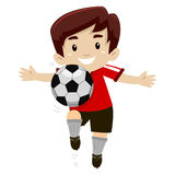 Pontapé do jogador de futebol uma bola de futebol Fotografia de Stock Royalty Free