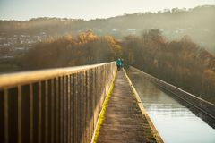 Pontcysyllte Aqueduct with Llangollen Canal in Wales, UK. Pontcysyllte Aqueduct is a navigable aqueduct that carries the Llangollen Canal across the River Dee in stock photos