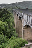 Pontcysyllte aqueduct in Wales. Scenic picture on an overcast day of a welsh hillside.  Pontcysyllte aqueduct Trees and mountain in the distance Stock Photography