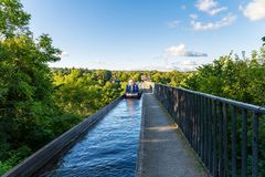 Pontcysyllte Aqueduct, Wrexham, Wales, UK. Near Froncysyllte, Wrexham, Wales, UK - August 30, 2016: People stering a Narrowboat over the Pontcysyllte Aqueduct Stock Photos