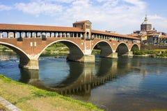 Pavia, Italy. The Ponte Coperto covered bridge, also known as the Ponte Vecchio old bridge, a brick and stone arch bridge over the Ticino River in Pavia, Italy royalty free stock photos