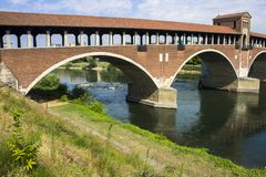 Pavia, Italy. The Ponte Coperto covered bridge, also known as the Ponte Vecchio old bridge, a brick and stone arch bridge over the Ticino River in Pavia, Italy royalty free stock photography