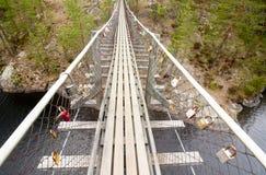 Ponte de corda no parque nacional Repovesi, Finlandia Imagens de Stock