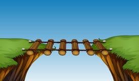 Ponte de madeira entre penhascos ilustração do vetor