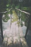 Ponte de madeira velha sob a água Foto de Stock Royalty Free