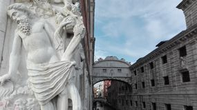 Ponte dei Sospiri and close-up with a human statue in Venice, Italy Stock Photography