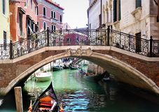 Venice, Italy - a picturesque view of Ponte del Angelo bridge, a turquoise canal and colorful old houses stock photography