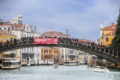 Ponte dell Academia. VENICE, ITALY - FEBRUARY 15 : People walking on the Ponte dell Accademia bridge on February 15th, 2014 in Venice, Italy. Ponte dell Stock Image