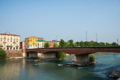 Ponte delle navi in Verona a bridge in northern Italy. Ponte delle navi in Verona, northern Italy. Civilian urban part of Verona with resident blocks and trees royalty free stock images