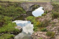 Ponte di pietra dell'arco scenico Fotografia Stock