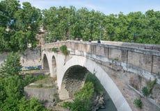Ponte Fabricio and Isola Tiberina in Rome, Italy stock photos