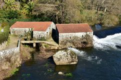 River with old stone water mill. Ponte Maceira, Coruna, Galicia, Spain. royalty free stock images