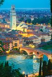 Ponte Pietra and Adige at night, Verona, Italy. Ancient Roman bridge Ponte Pietra on River Adige and Verona cathedral Duomo at night illumination, view from Royalty Free Stock Photography