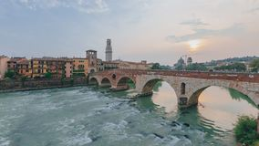 Ponte Pietra over Adige river, with the bell tower of Verona cathedral, in Verona, Italy stock image