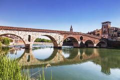 Ponte Pietra is a Roman arch bridge over the Adige river in the Italian city of Verona Stock Image