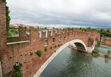 The Ponte Pietra Stone Bridge, once known as the Pons Marmoreus, is a Roman arch bridge crossing the Adige River in Verona, Ital Stock Photos