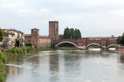 The Ponte Pietra Stone Bridge, once known as the Pons Marmoreus, is a Roman arch bridge crossing the Adige River in Verona Stock Photos