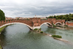 The Ponte Pietra Stone Bridge, once known as the Pons Marmoreus, is a Roman arch bridge crossing the Adige River in Verona, Stock Image