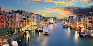 Ponte Rialto and gondola at sunset in Venice, Italy Stock Photos