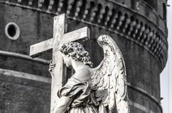 Ponte Sant`Angelo angel with cross. Black white picture Royalty Free Stock Photo